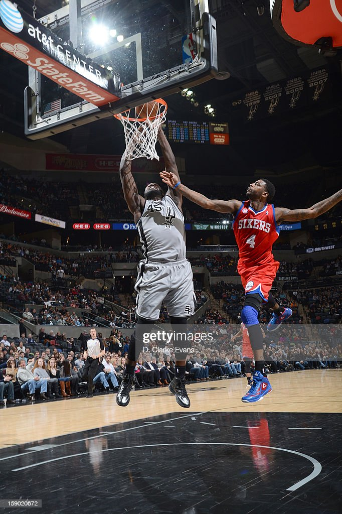 <a gi-track='captionPersonalityLinkClicked' href=/galleries/search?phrase=DeJuan+Blair&family=editorial&specificpeople=4649451 ng-click='$event.stopPropagation()'>DeJuan Blair</a> #45 of the San Antonio Spurs goes to the basket against <a gi-track='captionPersonalityLinkClicked' href=/galleries/search?phrase=Dorell+Wright&family=editorial&specificpeople=211344 ng-click='$event.stopPropagation()'>Dorell Wright</a> #4 of the Philadelphia 76ers during the game between the Philadelphia 76ers and the San Antonio Spurs on January 5, 2013 at the AT&T Center in San Antonio, Texas.