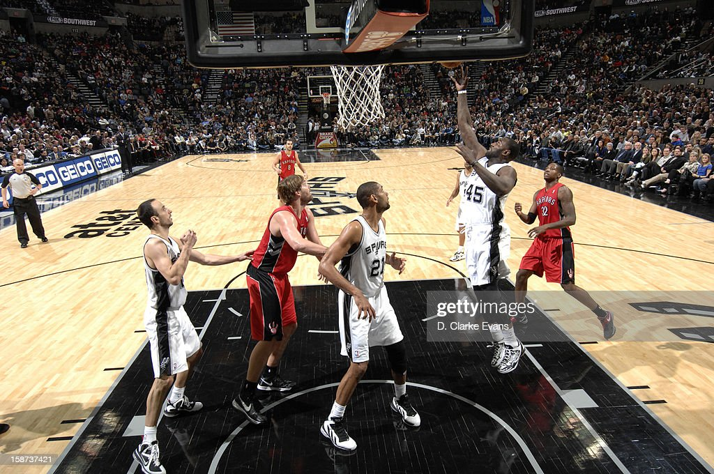 <a gi-track='captionPersonalityLinkClicked' href=/galleries/search?phrase=DeJuan+Blair&family=editorial&specificpeople=4649451 ng-click='$event.stopPropagation()'>DeJuan Blair</a> #45 of the San Antonio Spurs goes to the basket during the game between the Toronto Raptors and the San Antonio Spurs on December 26, 2012 at the AT&T Center in San Antonio, Texas.
