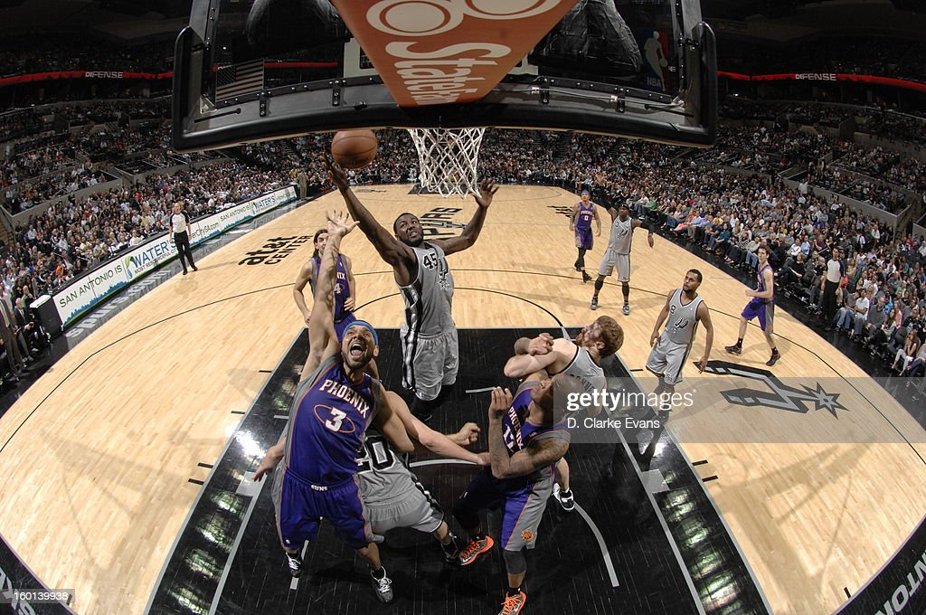 DeJuan Blair #45 of the San Antonio Spurs goes up for a rebound against the Phoenix Suns on January 26, 2013 at the AT&T Center in San Antonio, Texas.