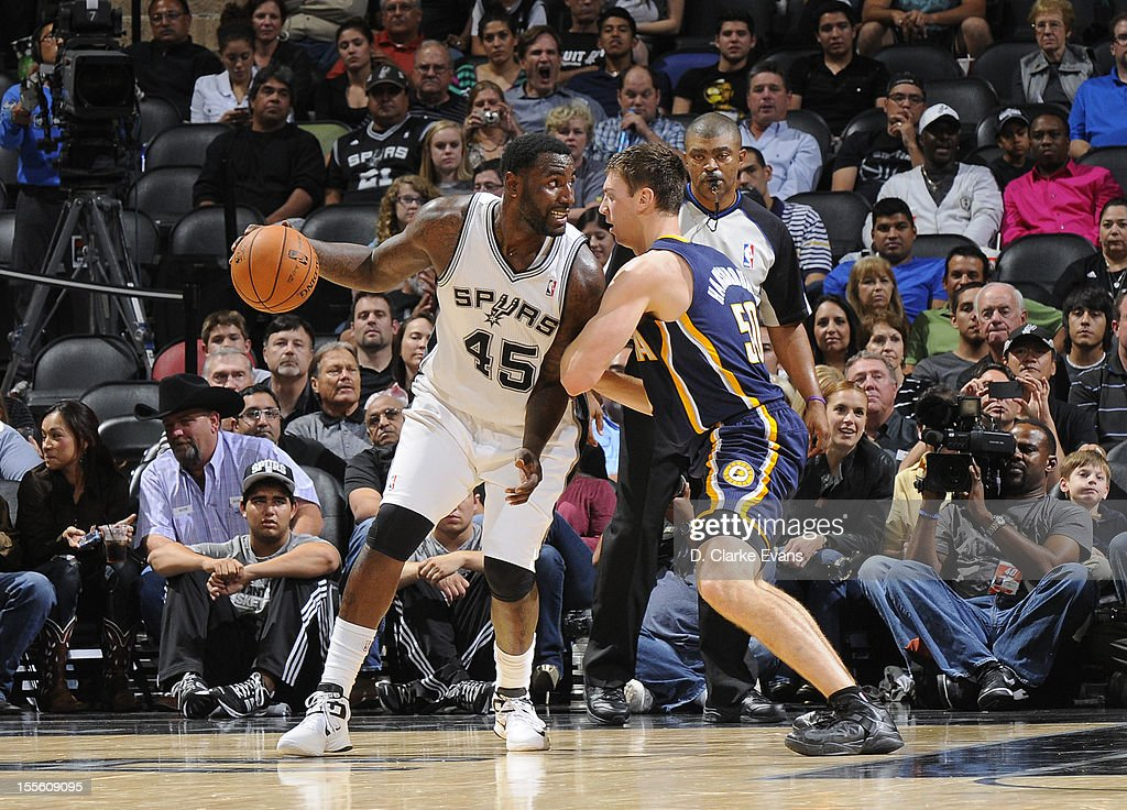 <a gi-track='captionPersonalityLinkClicked' href=/galleries/search?phrase=DeJuan+Blair&family=editorial&specificpeople=4649451 ng-click='$event.stopPropagation()'>DeJuan Blair</a> #45 of the San Antonio Spurs protects the ball grom <a gi-track='captionPersonalityLinkClicked' href=/galleries/search?phrase=Tyler+Hansbrough&family=editorial&specificpeople=642794 ng-click='$event.stopPropagation()'>Tyler Hansbrough</a> #50 of the Indiana Pacers during the game between the Indiana Pacers and the San Antonio Spurs on November 5, 2012 at the AT&T Center in San Antonio, Texas.