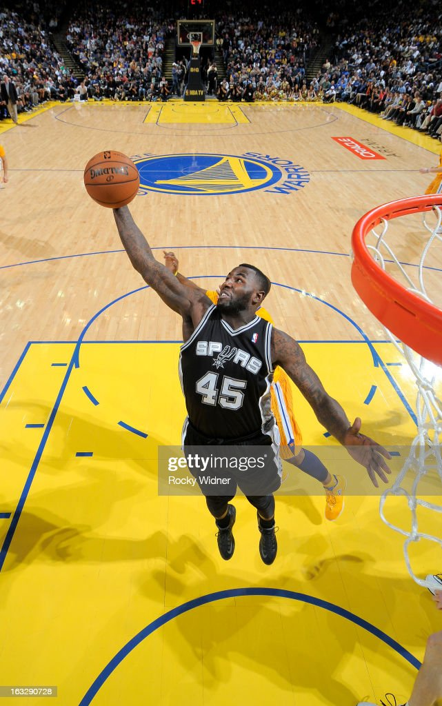 DeJuan Blair #45 of the San Antonio Spurs rebounds against the Golden State Warriors on February 22, 2013 at Oracle Arena in Oakland, California.