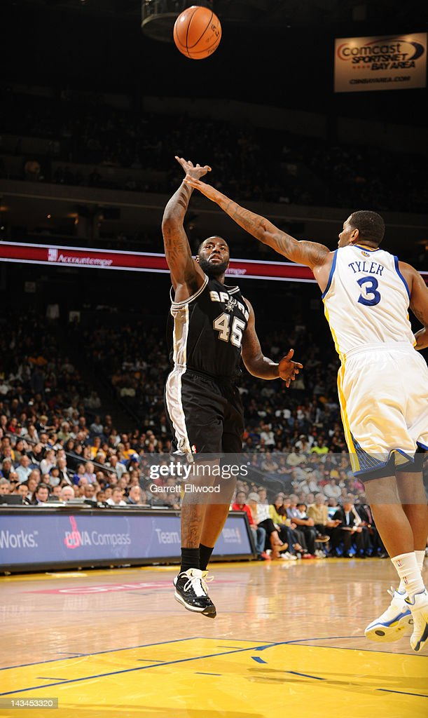 DeJuan Blair #45 of the San Antonio Spurs shoots against Jeremy Tyler #3 of the Golden State Warriors on April 26, 2012 at Oracle Arena in Oakland, California.