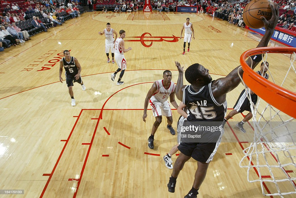 <a gi-track='captionPersonalityLinkClicked' href=/galleries/search?phrase=DeJuan+Blair&family=editorial&specificpeople=4649451 ng-click='$event.stopPropagation()'>DeJuan Blair</a> #45 of the San Antonio Spurs shoots the ball against the Houston Rockets during a pre-season game on October 14, 2012 at the Toyota Center in Houston, Texas.