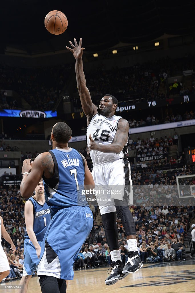 DeJuan Blair #45 of the San Antonio Spurs shoots the ball over Derrick Williams #7 of the Minnesota Timberwolves during a game played on April 17, 2013 at the AT&T Center in San Antonio, Texas.
