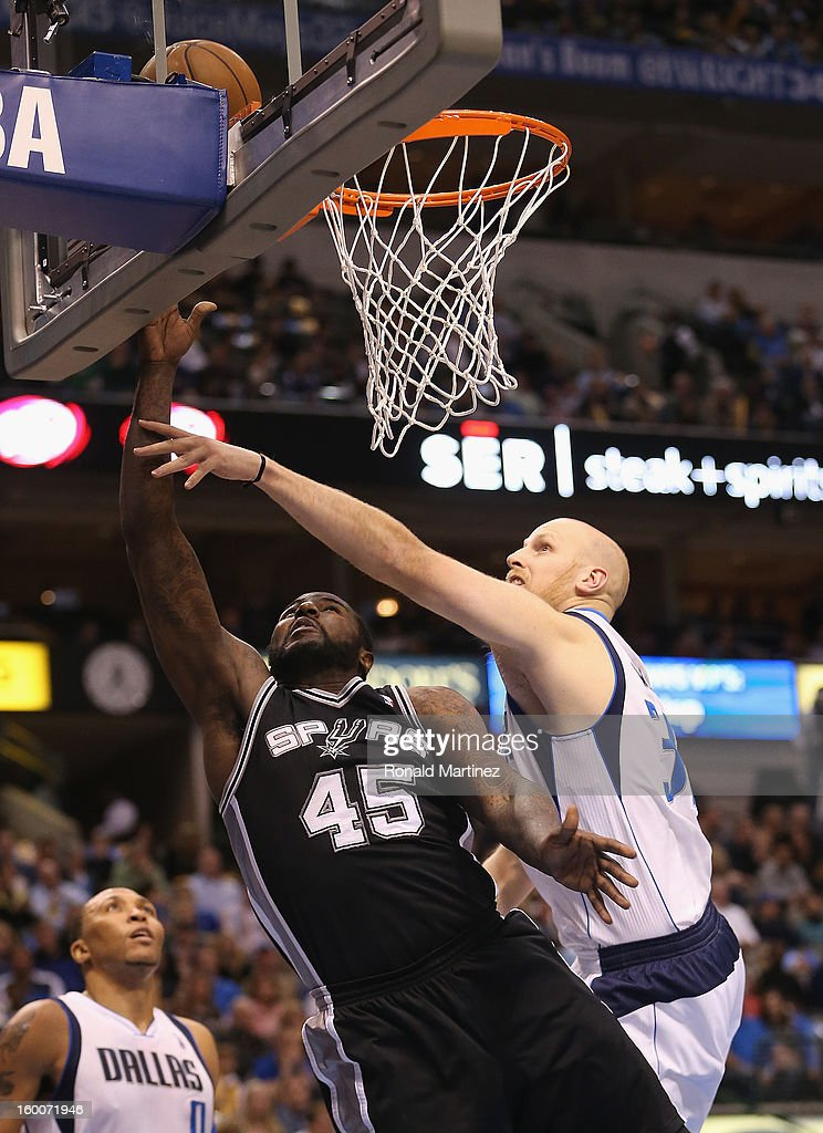 DeJuan Blair #45 of the San Antonio Spurs takes a shot against Chris Kaman #35 of the Dallas Mavericks at American Airlines Center on January 25, 2013 in Dallas, Texas.