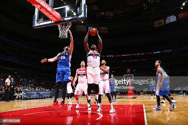 DeJuan Blair of the Washington Wizards grabs the rebound against the Philadelphia 76ers during a preseason game on October 6 2015 at Verizon Center...