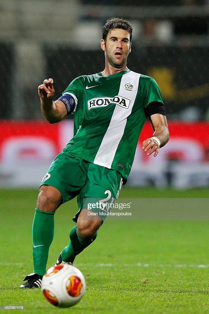 <a gi-track='captionPersonalityLinkClicked' href=/galleries/search?phrase=Dekel+Keinan&family=editorial&specificpeople=1602113 ng-click='$event.stopPropagation()'>Dekel Keinan</a> of Maccabi Haifa in action during the UEFA Europa League Group L match between AZ Alkmaar and Maccabi Haifa FC at the AFAS Stadium on November 28, 2013 in Alkmaar, Netherlands.