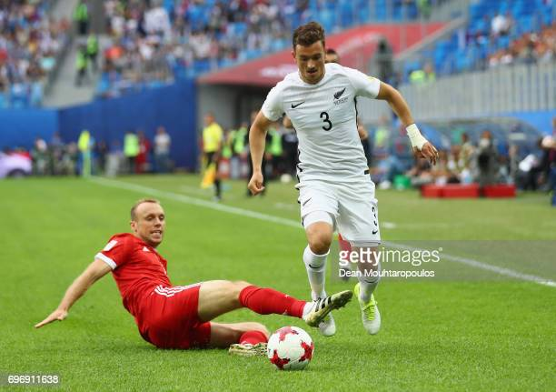 Deklan Wynne of New Zealand takes the ball past Dennis Glushakov of Russia during the FIFA Confederations Cup Russia 2017 Group A match between...