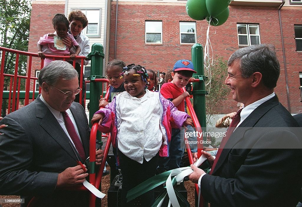 Deknequa Johnson, 4, shares and laugh and ribbon cutting honors with Mayor Tom Menino and Acting Governor Paul Cellucci during the grand opening of the GrandFamilies House and playground in Dorchester Thursday where grandparents and their grandchildren will live together. The house is the first of its kind in the nation to address the growing needs of grandparents raising their grandchildren. There are an estimated 10,000 such children in the Greater Boston area. jmg