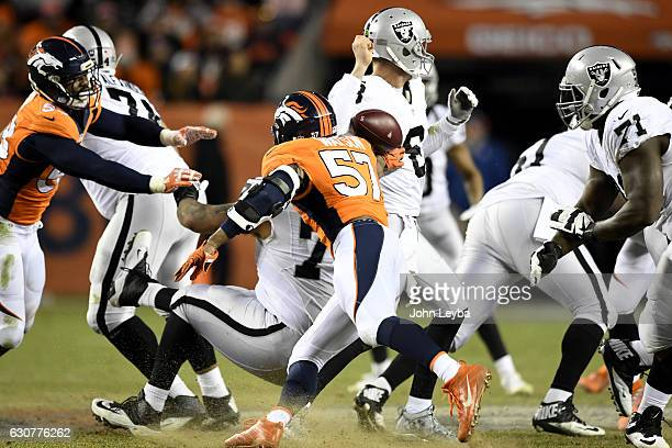 Dekoda Watson of the Denver Broncos hits Connor Cook of the Oakland Raiders during the fourth quarter of the Broncos' 246 win on Sunday January 1...