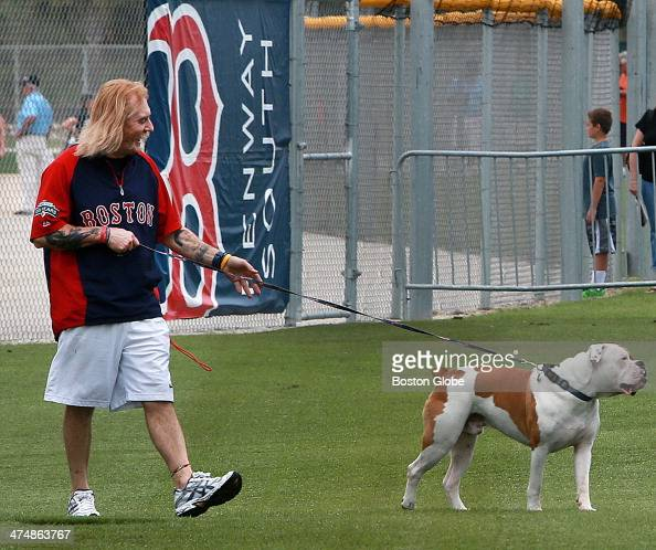 Del Christman the clubhouse manager for the Red Sox affiliate Lowell Spinners who is known as 'Dog Man' takes the JetBlue clubhouse dog Homer out for...