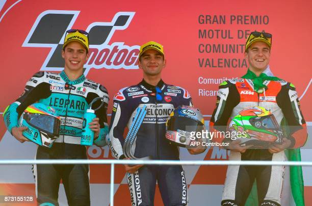 Del Conca Gresini Moto3 Spanish rider Jorge Martin celebrates on the podium next to Leopard Racing Spanish rider Joan Mir and Platinum Bay Real...
