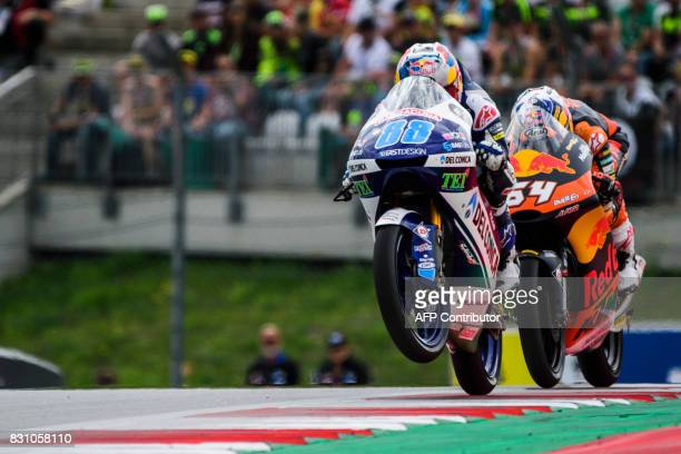 Del Conca Gresini Moto3's Spanish rider Jorge Martin and Red Bull KTM Ajo's Dutch rider Bo Bendsneyder compete during Austrian Grand Prix race at Red...