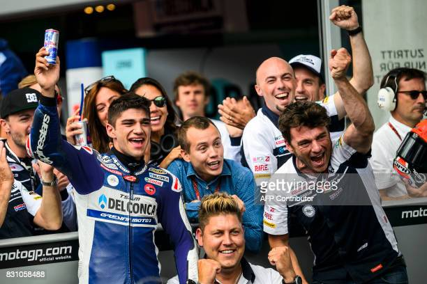 Del Conca Gresini Moto3's Spanish rider Jorge Martin celebrates with his team after placing third during the Moto3 Austrian Grand Prix race at Red...