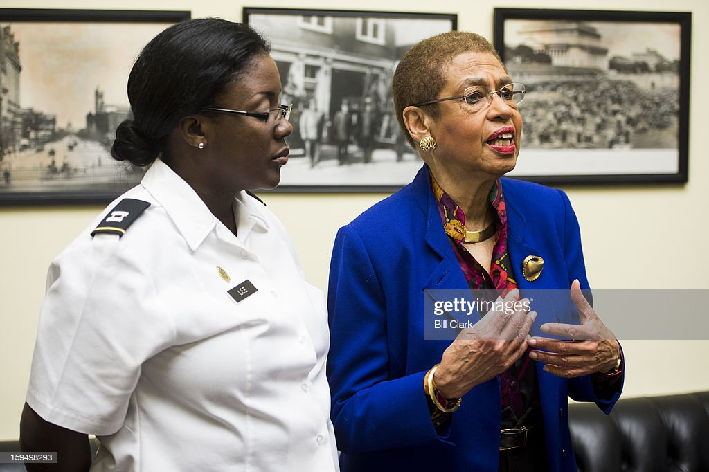 Del. Eleanor Holmes Norton, D-DC, speaks about Inauguration preparations in Washington as DC National Guardsmen Captain Yolanda Lee listens before the Inauguration ticket lottery on Monday, Jan. 14, 2013. Norton's office received thousands of ticket requests, but only has about 200 tickets to dole out.