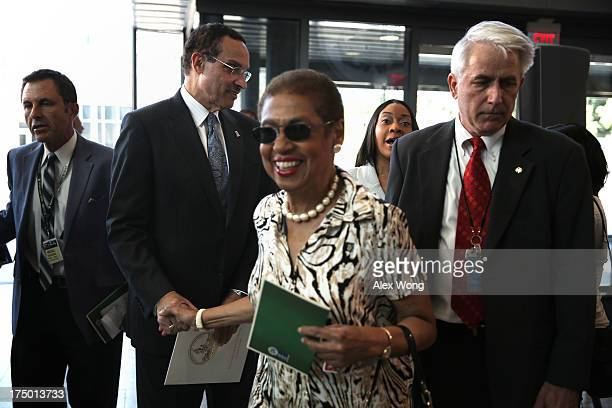S Del Eleanor Holmes Norton greets DC Mayor Vincent Gray during the opening of the new US Coast Guard Headquarters July 29 2013 in Washington DC The...