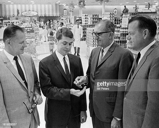 JUL 9 1969 JUL 10 1969 Del Farm Opens 28th Denver Store Jim Richards manager of the newest Del Farm super market in the Denver area accepts the keys...