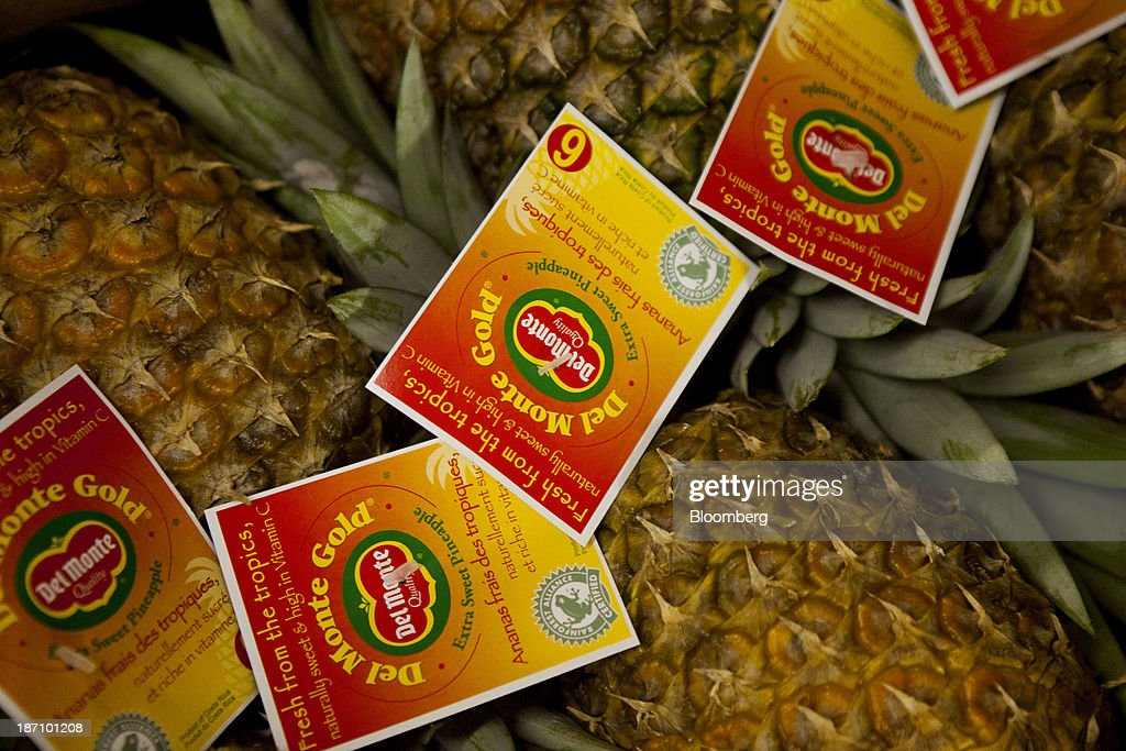 Del Monte Corp. pineapples sit in crates at the Specialty Produce warehouse in San Diego, California, U.S., on Friday, Nov. 1, 2013. The U.S. Bureau of Economic Analysis is scheduled to release gross domestic product (GDP) figures on Nov. 7. Photographer: Sam Hodgson/Bloomberg via Getty Images