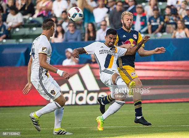 A J DeLaGarza of Los Angeles Galaxy battles Mike Grella of New York Red Bulls during Los Angeles Galaxy's MLS match against the New York Red Bulls at...