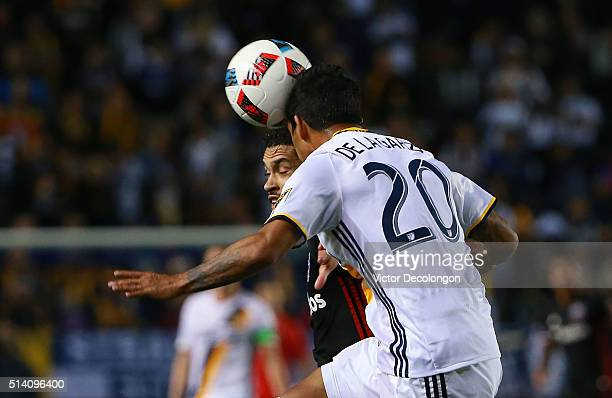 A J DeLaGarza of Los Angeles Galaxy heads the ball clear from Lamar Neagle of DC United in the first half of their MLS match at StubHub Center on...
