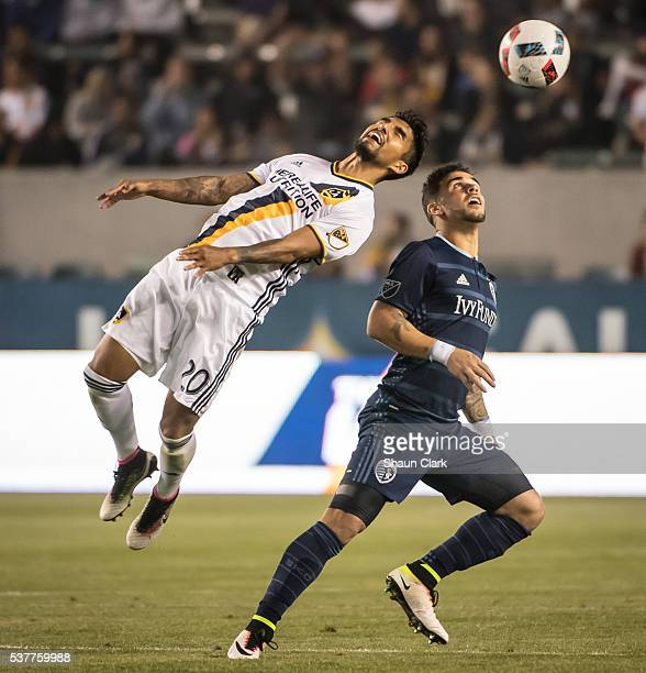 A J DeLaGarza of Los Angeles Galaxy heads the ball during Los Angeles Galaxy's MLS match against Sporting KC at the StubHub Center on June 2 2016 in...