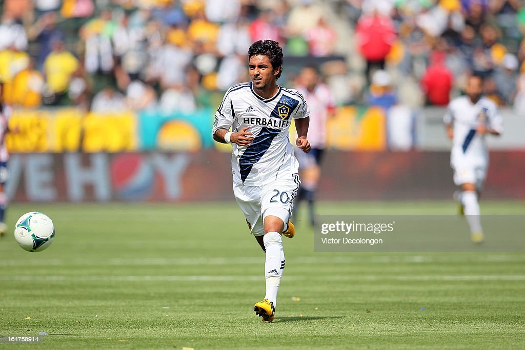 A.J. DeLaGarza #20 of the Los Angeles Galaxy chases after the ball in the defensive zone during the MLS match against Chivas USA at The Home Depot Center on March 17, 2013 in Carson, California. Chivas USA and the Los Angeles Galaxy played to a 1-1 draw.