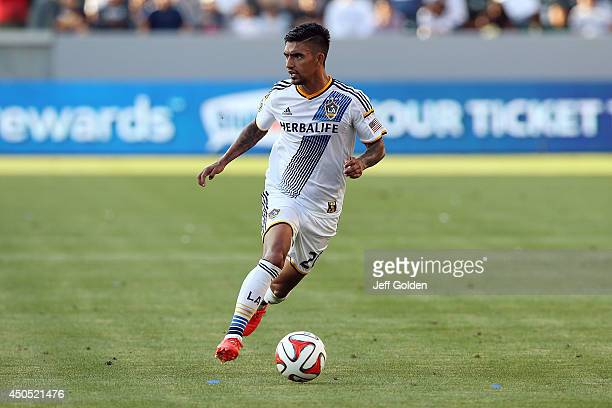 J DeLaGarza of the Los Angeles Galaxy dribbles the ball while airborne against the Philadelphia Union in the second half of the MLS match at StubHub...
