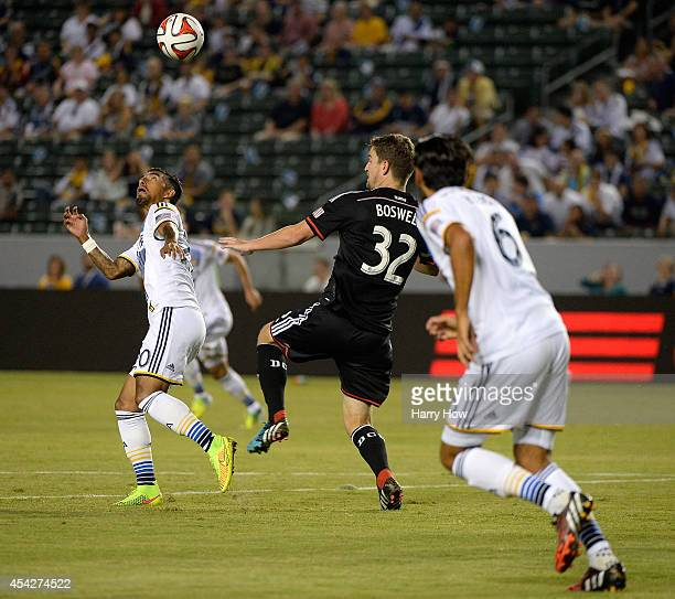 J DeLaGarza of the Los Angeles Galaxy looks up for the ball as Bobby Boswell of DC United defends during the first half at StubHub Center on August...