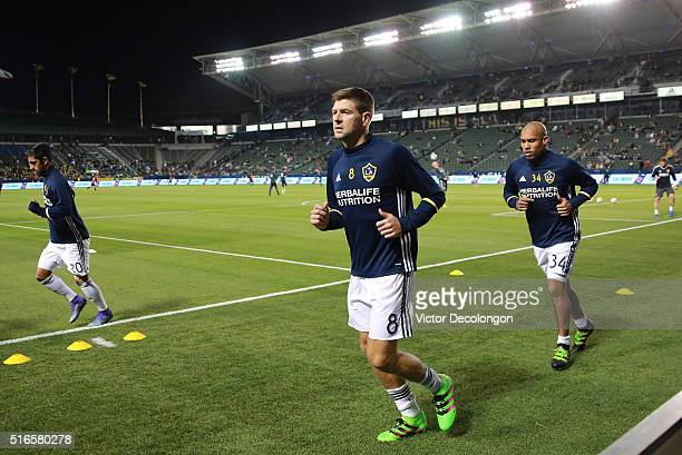 A J DeLaGarza Steven Gerrard and Nigel de Jong of the Los Angeles Galaxy warm up prior to the MLS match against DC United at StubHub Center on March...