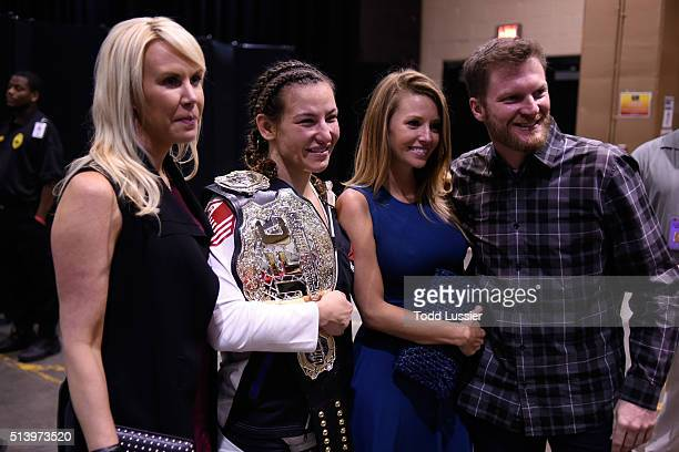 DeLana Harvick Miesha Tate Amy Reimann and NASCAR driver Dale Earnhardt Jr backstage during the UFC 196 event inside MGM Grand Garden Arena on March...