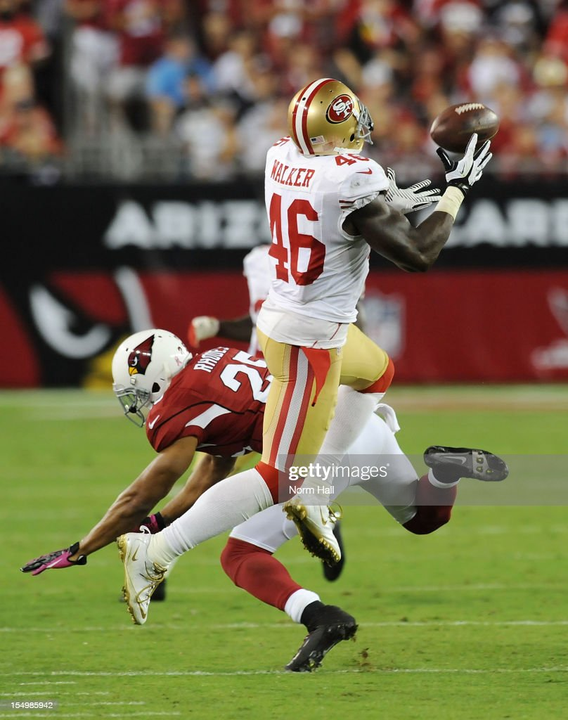 Delanie Walker $46 of the San Francisco 49ers makes a catch in front of a diving Kerry Rhodes of the Arizona Cardinals at University of Phoenix...