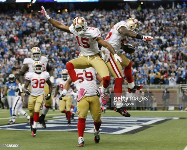 Delanie Walker and Michael Crabtree of the San Francisco 49ers celebrate a touchdown late in the game against the Detroit Lions during a NFL game at...
