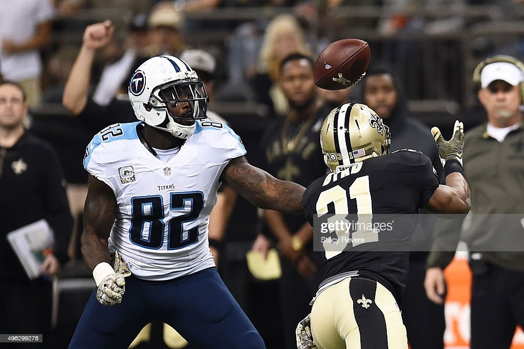 Delanie Walker of the Tennessee Titans and Jairus Byrd of the New Orleans Saints reach for a loose ball during the second quarter of a game at the...