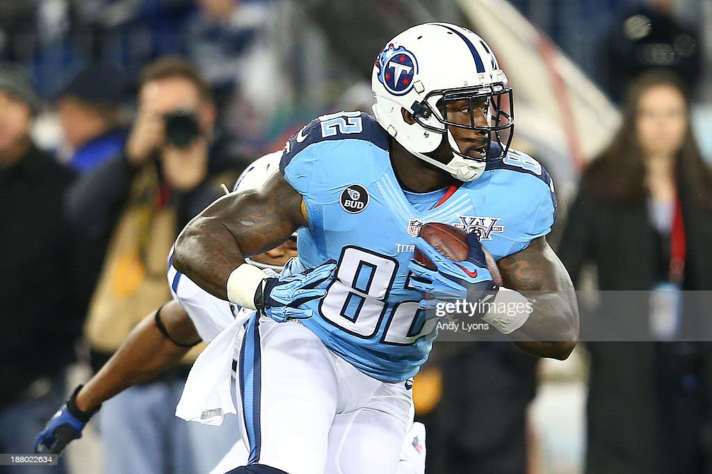 Delanie Walker of the Tennessee Titans carries the ball against the Indianapolis Colts in the first quarter at LP Field on November 14 2013 in...