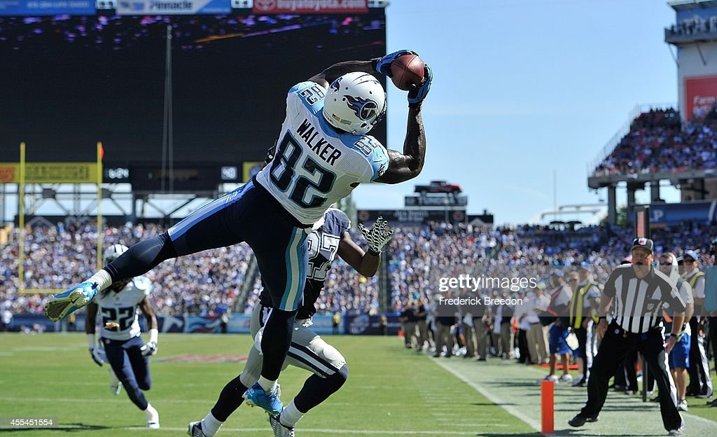 Delanie Walker of the Tennessee Titans catches the ball in the end zone moments before landing out of bounds for an incomplete pass against the...