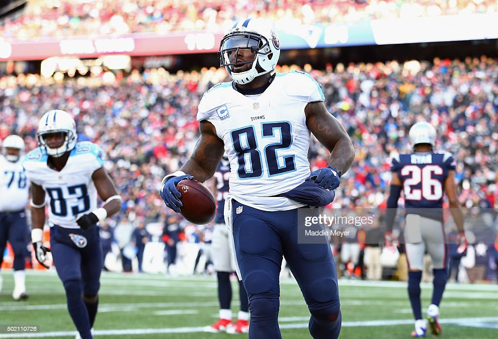 Delanie Walker of the Tennessee Titans celebrates scoring a touchdown during the second half against the New England Patriots at Gillette Stadium on...