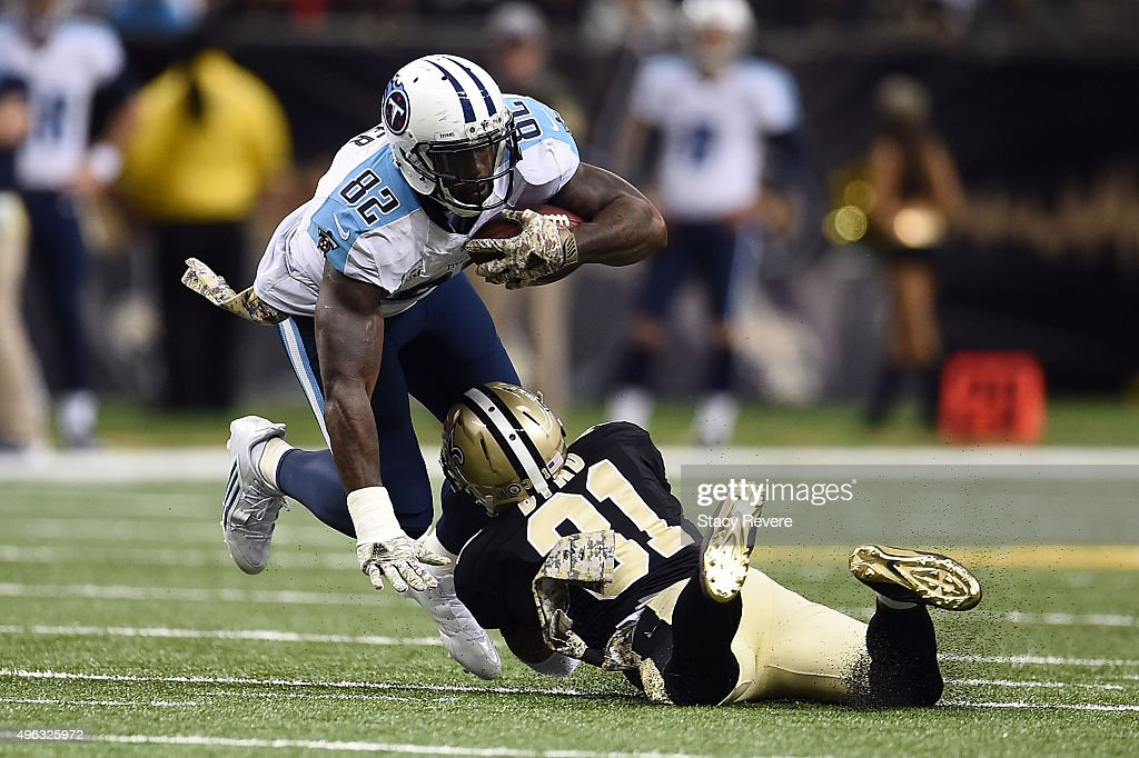 Delanie Walker of the Tennessee Titans is brought down by Jairus Byrd of the New Orleans Saints during the fourth quarter of a game at the...