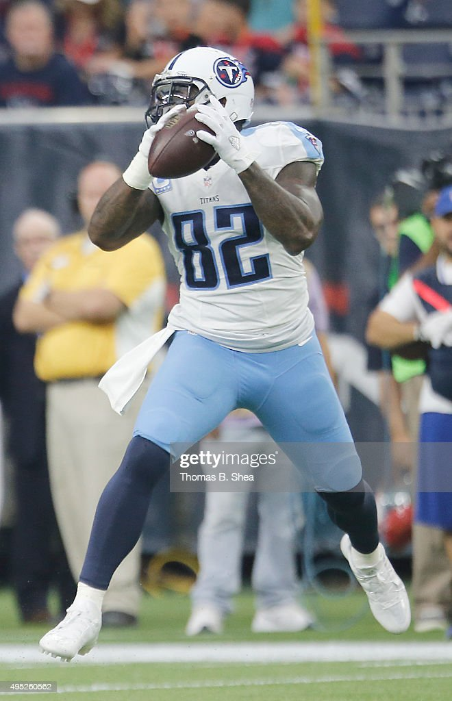 Delanie Walker of the Tennessee Titans makes a catch against the Houston Texans in the first quarter on November 1 2015 at NRG Stadium in Houston...