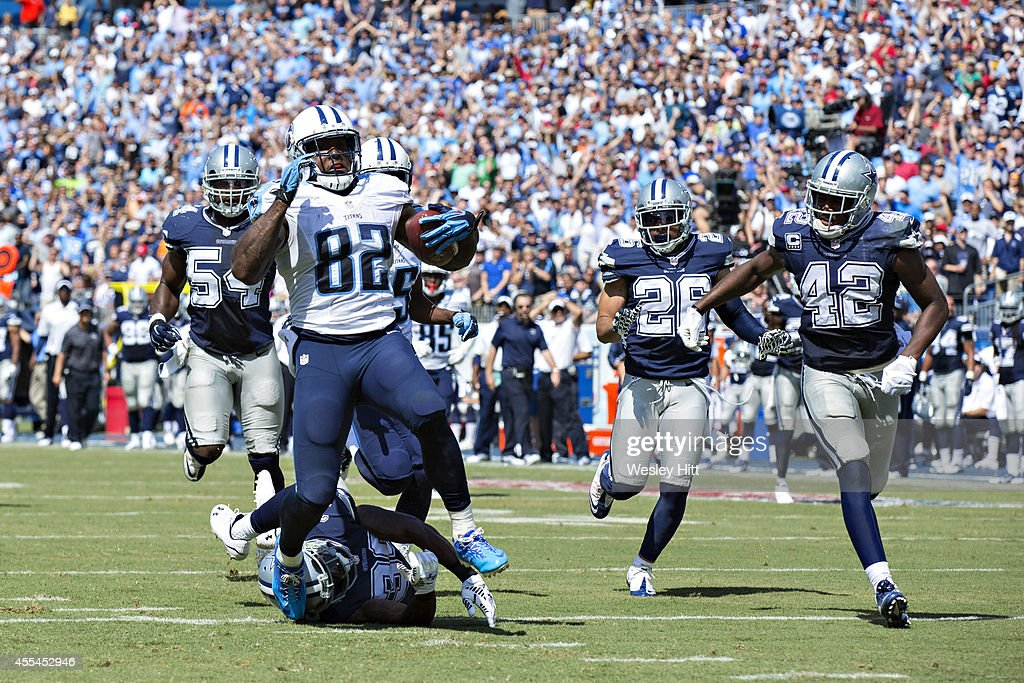 Delanie Walker of the Tennessee Titans runs for a touchdown after catching a pass against the Dallas Cowboys at LP Field on September 14 2014 in...