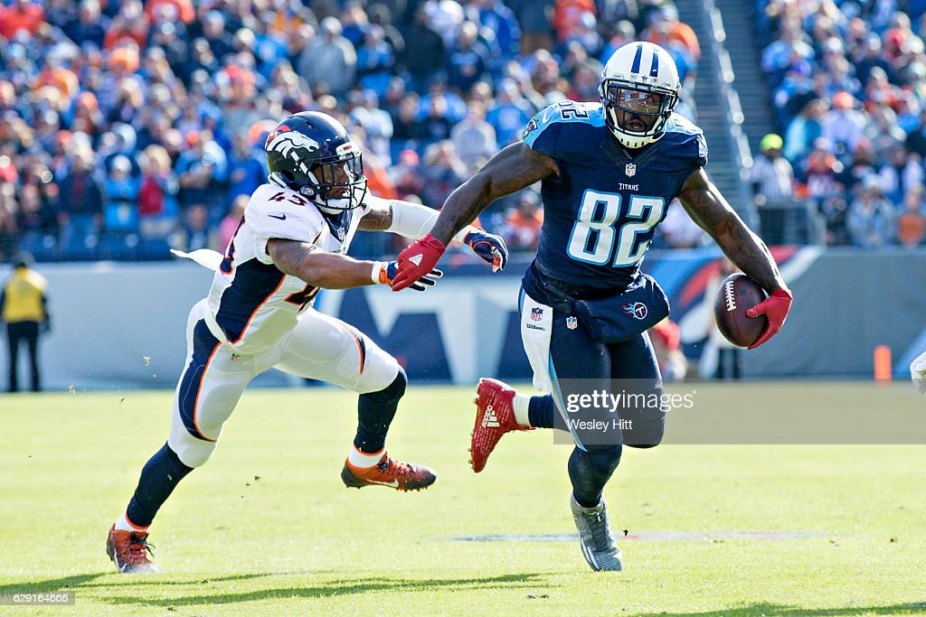 Delanie Walker #82 of the Tennessee Titans runs the ball after catching a pass and avoids T.J. Ward #43 of the Denver Broncos at Nissan Stadium on December 11, 2016 in Nashville, Tennessee. The Titans defeated the Broncos 13-10.