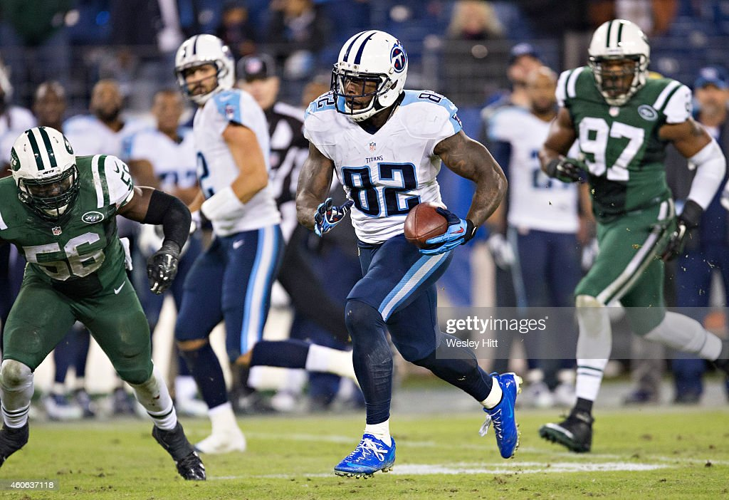 Delanie Walker of the Tennessee Titans runs the ball at the end of the game against the New York Jets at LP Field on December 14 2014 in Nashville...