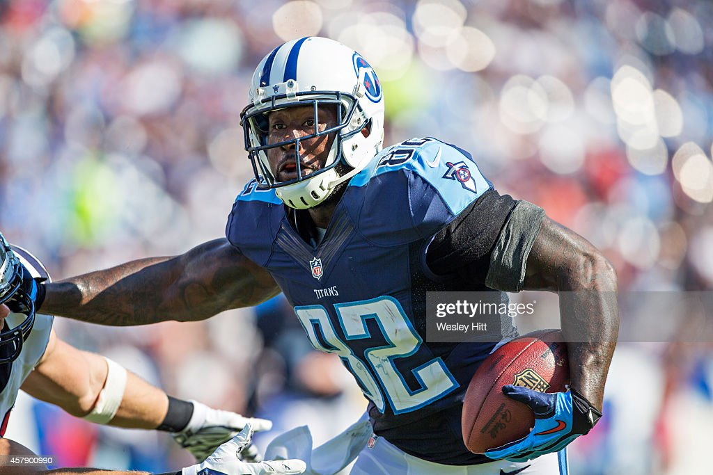 Delanie Walker of the Tennessee Titans runs the ball in the third quarter against the Houston Texans at LP Field on October 26 2014 in Nashville...