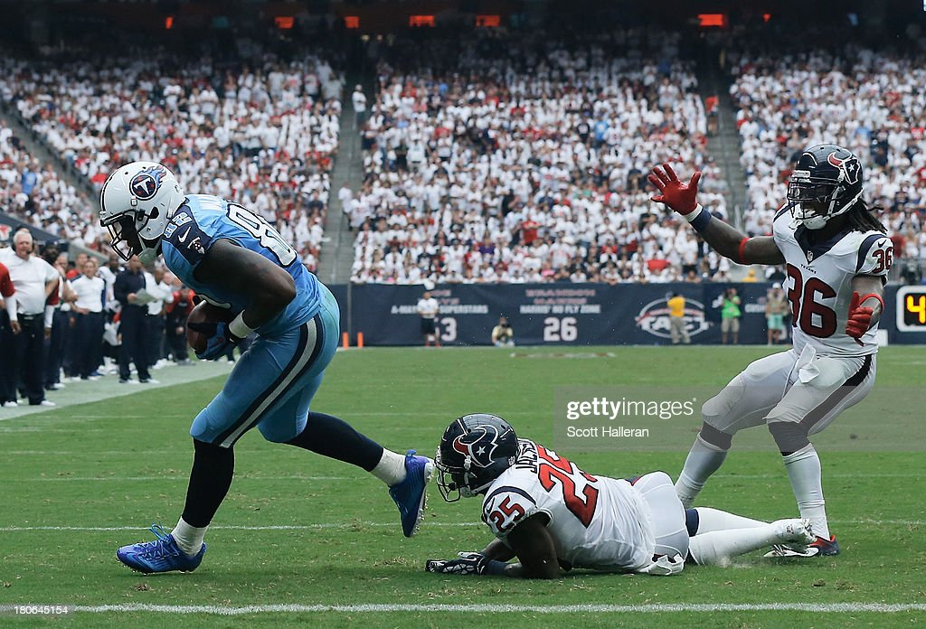 Delanie Walker of the Tennessee Titans scores a touchdown in the fourth quarter against the Houston Texans at Reliant Stadium on September 15 2013 in...