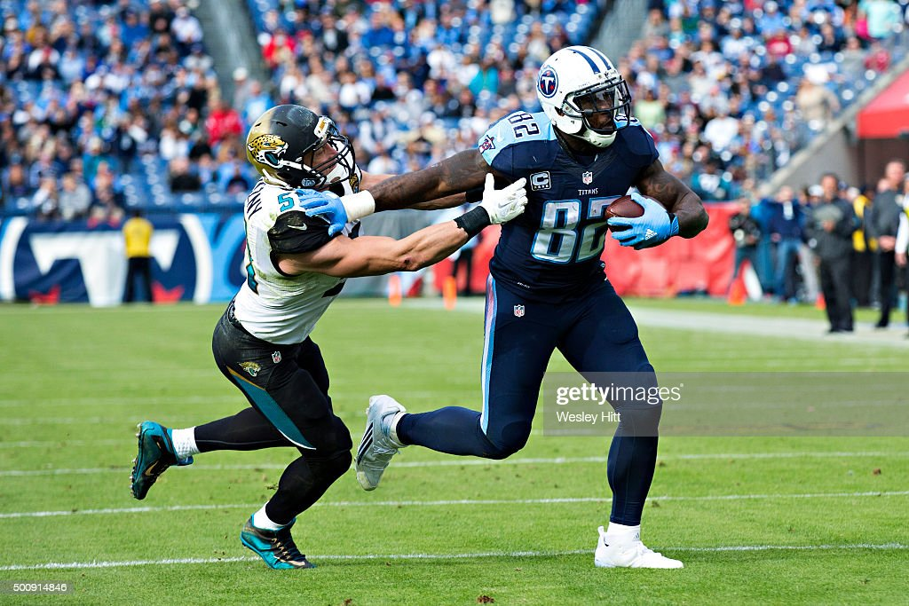 Delanie Walker of the Tennessee Titans tries to avoid the tackle of Paul Posluszny of the Jacksonville Jaguars at Nissan Stadium on December 6 2015...