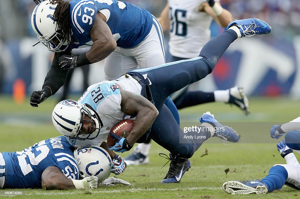 Delanie Walker#82 of the Tennessee Titans is tripped up during the game against the Indianapolis Colts at LP Field on December 28 2014 in Nashville...