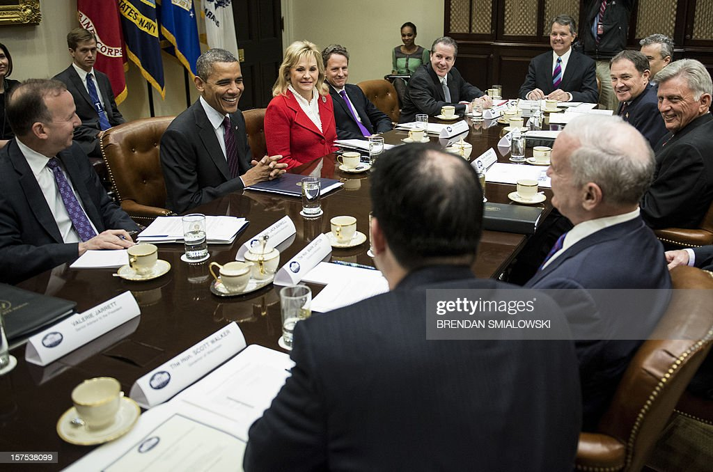 Delaware Governor Jack Markell (L), Chair of the National Governors Association's Executive Committee, US President Barack Obama (2L), Oklahoma Governor Mary Fallin (3L), Vice Chair of the National Governors Association's Executive Committee, US Secretary of the Treasury Timothy F. Geithner (4L), Wisconsin Governor Scott Walker (5L), Minnesota Governor Mark Dayton (3R), Utah Governor Gary Herbert (2R), and Arkansas Governor Mike Beebe (R), and others wait for a meeting in the Roosevelt Room of the White House December 4, 2012 in Washington, DC. Obama and Vice President Joe Biden met with state governors to speak about impending tax hikes and speeding cuts dictated by the Budget Control Act of 2011 if Congress cannot compromise on reducing the budget's deficit. AFP PHOTO/Brendan SMIALOWSKI