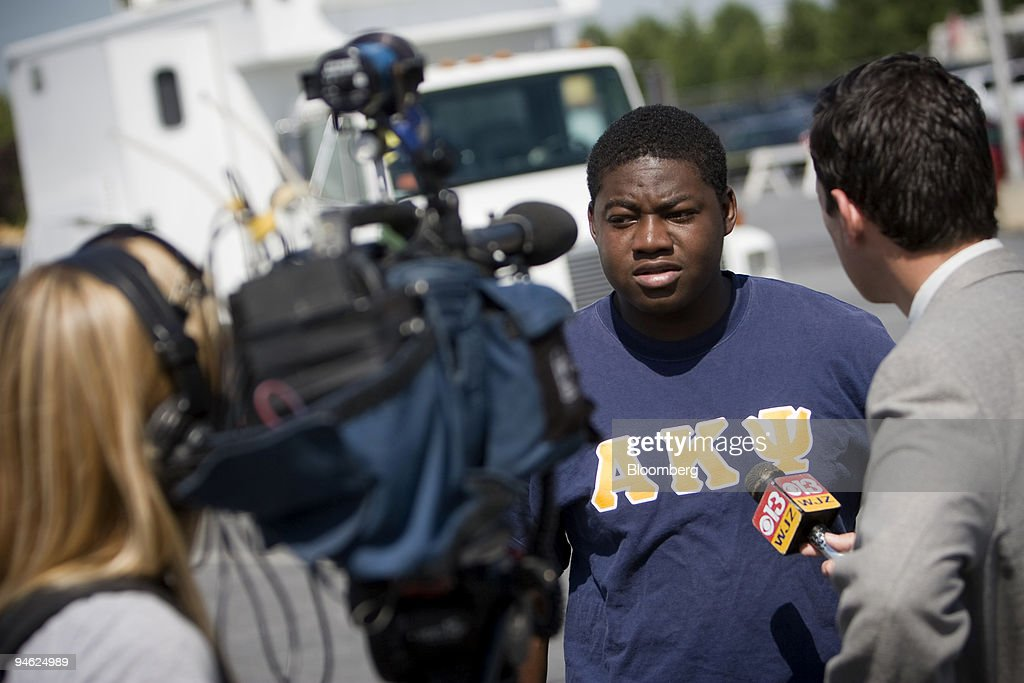 Delaware State University junior Chris Beugre speaks to reporters about receiving a text message from a friend alerting him about a shooting at the...