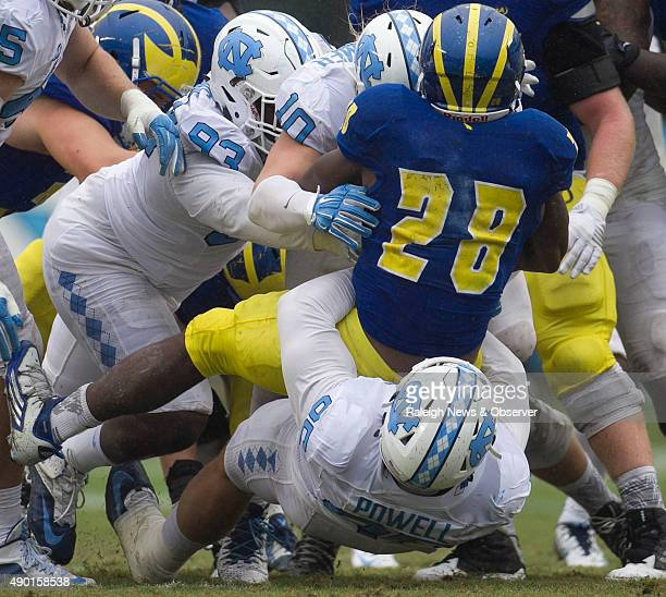 Delaware's Thomas Jefferson is stopped by North Carolina's Tyler Powell Jeff Schoettmer and Robert Dinkins after a 3yard gain in the fourth quarter...