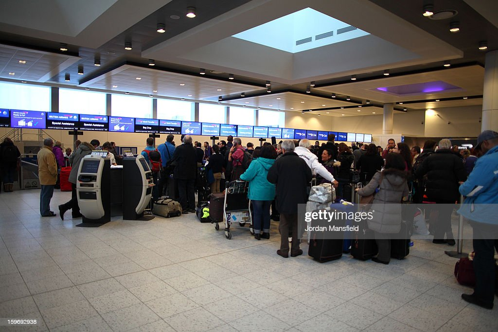 Delayed British Airways passengers wait in line at the check-in desk at Gatwick Airport's North Terminal on January 18, 2013 in London, United Kingdom. Widespread snowfall is affecting most of the UK with school closures and transport disruption. The Met Office has issued a red weather warning for parts of Wales, advising against all non-essential travel as up to 30cm of snow is expected to fall in some areas today.