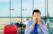 crying businessman who delayed flight at an airport
